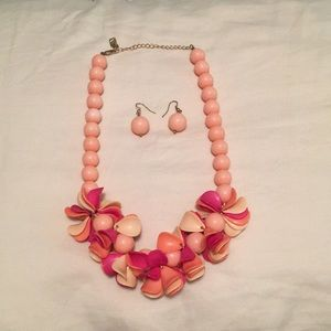 Whimsical bead necklace in shades of pink/orange